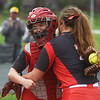 Brooke Bearden, left, hugs teammate and fellow senior Mallory Gazaway after Gazaway pitched to her for the ceremonial first pitch of Monday's game.<br /> Globe | Roger Nomer