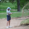 Joplin's Fielding Campbell hits out of a bunker on Monday at Carthage Golf Course.<br /> Globe | Roger Nomer