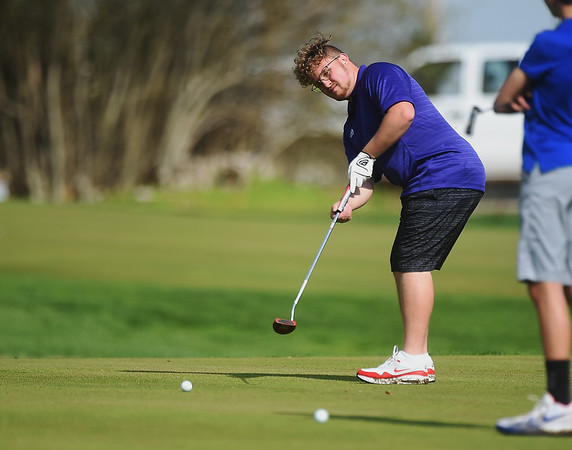 Landon Owens, a senior at Sarcoxie High School, putts on Monday at Schifferdecker Golf Course.<br /> Globe | Roger Nomer