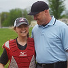 Brooke Bearden chats with umpire Brandon Smith before Monday's game in Liberal.<br /> Globe | Roger Nomer