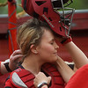 Brooke Bearden puts on a catcher mask as she prepares to take the field for a ceremonial first pitch on Monday in Liberal.<br /> Globe | Roger Nomer