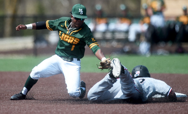 Central Missouri's Micah Evans (10) slides under the tag of Missouri Southern second baseman Dexter Swims (1) during their game on Saturday at Warren Turner Field. Globe | Laurie SIsk