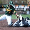 Central Missouri's Micah Evans (10) slides under the tag of Missouri Southern second baseman Dexter Swims (1) during their game on Saturday at Warren Turner Field.<br /> Globe | Laurie SIsk