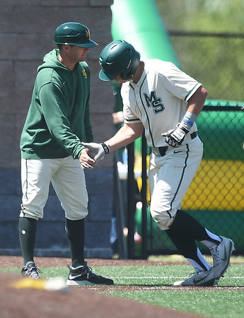 From the left: Missouri Southern third base coach Nick Tuck congratulates Troy Gagan after Gagan's grand slam during the Lions game against Northeastern State on Saturday at Warren Turner Field.<br /> Globe   Laurie Sisk