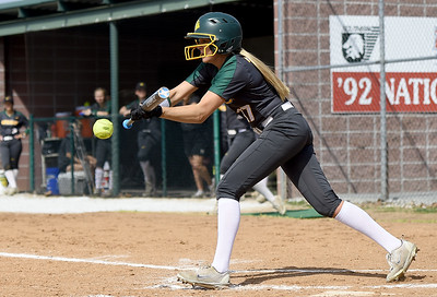 Missouri Southern's Tori Frazier tries to bunt her way onto first base during the Lions game against Southwest Baptist on Wednesday afternoon at Lea Kungle Field. Globe | Laurie Sisk