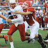 Globe/T. Rob Brown<br /> Carl Junction's Alex McMullen gets hold of Webb City quarterback John Roderique Friday night, Aug. 24, 2012, at Carl Junction's field.