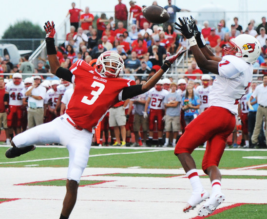 Globe/T. Rob Brown<br /> Webb City's Kiante Hardin attempts to intercept a ball intended for Carl Junction's Matt Magee Friday night, Aug. 24, 2012, at Carl Junction's field.