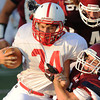 Globe/Roger Nomer<br /> Joplin High's Adam Norsworthy pulls down Seneca's Dylan Snow during Friday's jamboree.