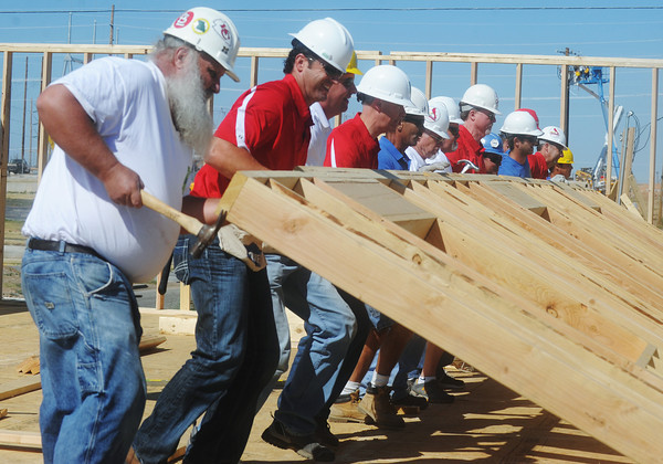 Globe/Roger Nomer<br /> Habitat for Humanity volunteers along with St. Louis Cardinals staff and coaches raise a wall at 2428 Joplin in Joplin, Mo. on Aug. 20, 2012.  The Cardinals baseball coaches and staff were in town to participate in the Governor's Cup Challenge, an effort by Habitat for Humanity to replace homes lost in the May 22, 2011, tornado in Joplin.
