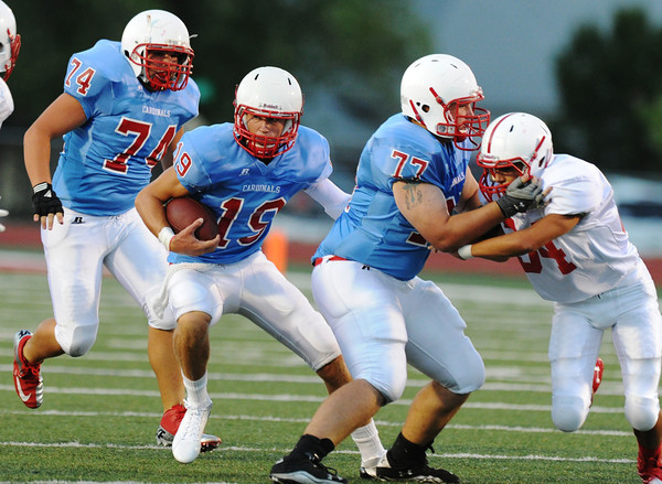 Globe/Roger Nomer<br /> Webb City's John Roderique (19) finds a big hole provided by Bruce Taft (74) and Brent Wilson's (77) block on Seneca's Braxton Graham during Friday's jamboree.