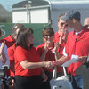 Globe/Roger Nomer<br /> Annette Thurston, executive director of Joplin's Ronald McDonald House, accepts a check for $20,00 from the Cardinals Care charity from St. Louis Cardinals Team President Bill DeWitt on Monday, Aug. 20, 1012, in Joplin, Mo.  Cardinals Care presented checks to five Joplin charities that work with children while Cardinals staff and coaches were in town to help with a Habitat for Humanity build to replace houses lost in the May 22, 2011, tornado.