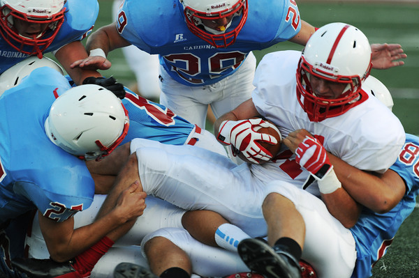 Globe/Roger Nomer<br /> Webb City defenders smother Seneca's Jalen Skaggs during Friday's jamboree.