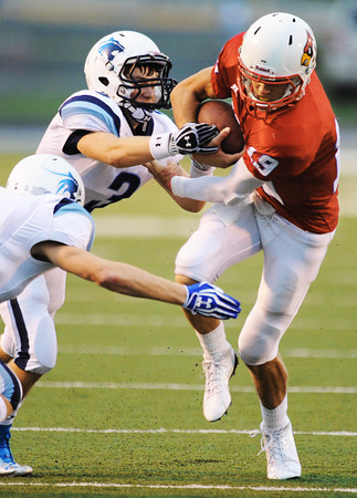 Globe/T. Rob Brown<br /> Webb City quarterback John Roderique works to avoid Har-Ber defenders Jerry Wood (left) and Dalton Clinkscales (3) during Friday night's game, Aug. 31, 2012, at Webb City's field.