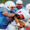 Globe/Roger Nomer<br /> Webb City's Tayler Arterburn sacks Seneca's Payton Rawlins for a loss during Friday's jamboree.