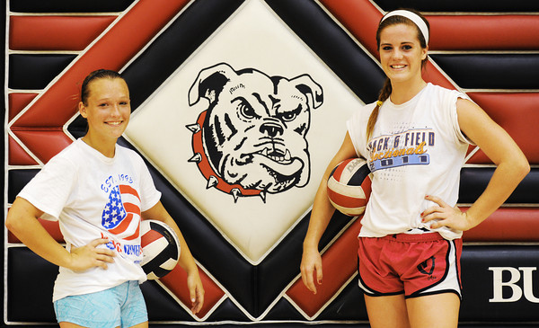 Globe/T. Rob Brown<br /> Carl Junction High School volleyball players junior Katie Wiele, left, and senior Hope Joyner Wednesday afternoon, Aug. 8, 2012, after practice in the school's gymnasium.