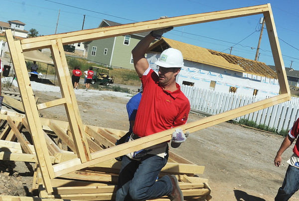 Globe/Roger Nomer<br /> St. Louis Cardinals General Manager John Mozeliak carries a wall during a Habitat for Humanity build at 2428 Joplin in Joplin, Mo., on Aug. 20, 2012.  The Cardinals baseball coaches and staff were in town to participate in the Governor's Cup Challenge, an effort by Habitat for Humanity to replace homes lost in the May 22, 2011, tornado in Joplin.