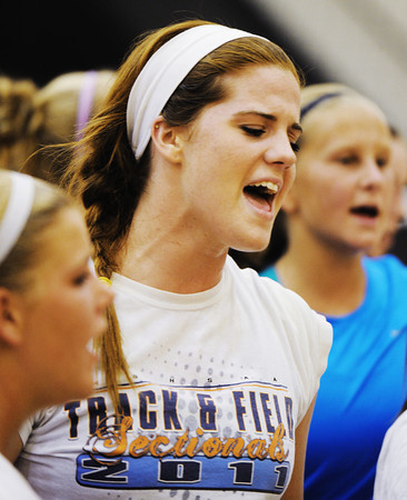 Globe/T. Rob Brown<br /> Carl Junction High School senior Hope Joyner yells a cheer with teammates during practice Wednesday afternoon, Aug. 8, 2012, in the school's gymnasium.