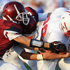 Globe/Roger Nomer<br /> Joplin's Adam Norsworthy, left, and Skyler Duley tackle Seneca's Marty Mailes during Friday's jamboree.