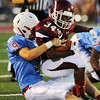 Globe/Roger Nomer<br /> Joplin's Chris Payton-Barba is wrapped up by Webb City's Nate Brown during Friday's jamboree.
