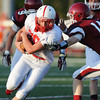 Globe/Roger Nomer<br /> Seneca's Marty Mailes runs by Joplin's Bryant Overstreet during Friday's jamboree.