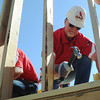 Globe/Roger Nomer<br /> St. Louis Cardinals Hitting Coach Mark McGwire hammers a nail to secure a wall during a Habitat for Humanity build at 2428 Joplin in Joplin, Mo., on Aug. 20, 2012.  The Cardinals baseball coaches and staff were in town to participate in the Governor's Cup Challenge, an effort by Habitat for Humanity to replace homes lost in the May 22, 2011, tornado in Joplin.