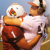 Globe/T. Rob Brown<br /> Webb City runningback Phoenix Johnson gets congratulated by coach John Roderique after Johnson scored the team's third touchdown against Har-Ber during Friday night's game, Aug. 31, 2012, at Webb City's field.