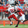 Globe/T. Rob Brown<br /> Webb City's Logan Williams heads toward the goal to score the second touchdown of the game as Carl Junction's Matt Magee puts on defensive pressure Friday night, Aug. 24, 2012, at Carl Junction's field.