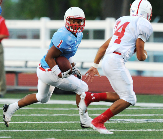 Globe/Roger Nomer<br /> Webb City's Phoenix Johnson looks for running room against Seneca on Friday.