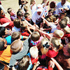 Globe/T. Rob Brown<br /> A group of Joplin school children huddle after a practice Thursday afternoon, Aug. 23, 2012, at Beacon School, the former Joplin School District administration offices. Administration and personnel for the Kansas City Chiefs helped build a new playground alongside Joplin School District personnel and volunteers.