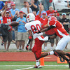 Globe/T. Rob Brown<br /> Webb City's Logan Williams scores the second touchdown of the game as Carl Junction's Matt Magee puts on defensive pressure Friday night, Aug. 24, 2012, at Carl Junction's field.
