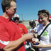 Globe/Roger Nomer<br /> St. Louis Cardinals Hitting Coach Mark McGwire signs a baseball for Emily Smith, Jefferson City, before Monday's build in Joplin.