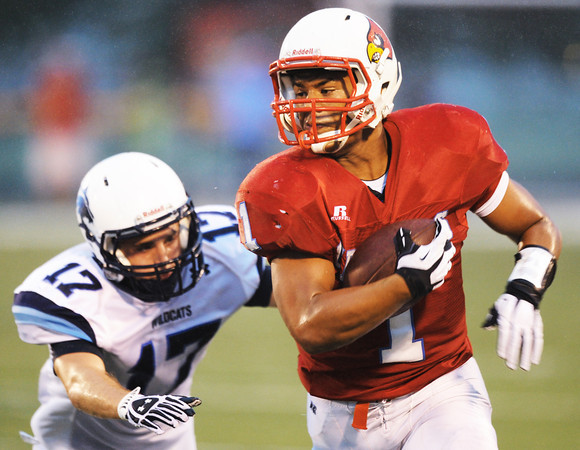 Globe/T. Rob Brown<br /> Webb City runningback Phoenix Johnson eludes Har-Ber's Hunter Patrick during Friday night's game, Aug. 31, 2012, at Webb City's field.