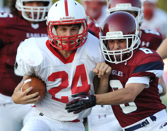 Globe/Roger Nomer<br /> Seneca's Dylan Snow tries to escape a tackle from Joplin's Adam Norsworthy during Friday's jamboree.