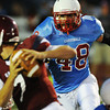 Globe/Roger Nomer<br /> Webb City's Jose Speer rushes the quarterback during Friday's jamboree.