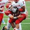 Globe/T. Rob Brown<br /> Carl Junction's Calvin Bremmerkamp brings down Webb City runningback Phoenix Johnson Friday night, Aug. 24, 2012, at Carl Junction's field.