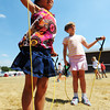 Globe/T. Rob Brown<br /> Six-year-old Emily Lynch, of Joplin, stretches with other children Thursday afternoon, Aug. 23, 2012, at Beacon School, the former Joplin School District administration offices. Administration and personnel for the Kansas City Chiefs helped build a new playground alongside Joplin School District personnel and volunteers.