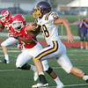 Globe/Roger Nomer<br /> Monett's Wesley Abramovitz carries the ball against Carl Junction during Friday's jamboree in Carl Junction.