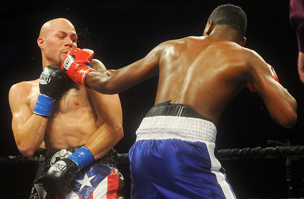Globe/Roger Nomer<br /> Jonathan Batista, left, lands a blow against Kermit Cintron during a welterweight bout at Buffalo Run Casino on Friday.