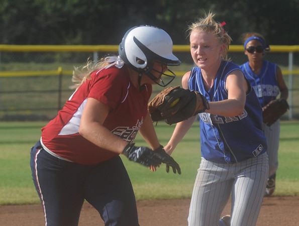 Globe/Roger Nomer<br /> Joplin's (#43, but no listed 43 on roster) gets caught in a rundown by Carthage's Amy Keller during Saturday's Paige Neal Christina Freeman Softball Tournament at the Joplin Athletic Complex.