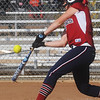 Globe/Roger Nomer<br /> Joplin's Jessica Greninger swings at a Carthage pitch during Saturday's Paige Neal Christina Freeman Softball Tournament at the Joplin Athletic Complex.