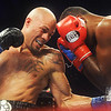 Globe/Roger Nomer<br /> Kermit Cintron, left, lands a body blow against Jonathan Batista during a welterweight bout at Buffalo Run Casino on Friday.