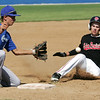 Globe/Roger Nomer<br /> Eden Prairie's Josh Miller slides safely into third in front of Carthage's Dausen Gourley during Thursday's game in Carthage.