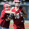 Globe/Roger Nomer<br /> Joplin High sophomore Nathaniel Rose, left, and junior Skyler Duley work on a ball protection drill during practice on Monday.