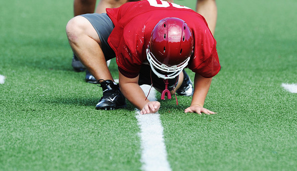Globe/Roger Nomer<br /> Joplin High junior Marshall Gabbard limbers up during a drill at practice on Monday.