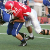 Globe/Roger Nomer<br /> Carl Junction's Kitch Channell tackles Carthage's Skyler Bloomer during Friday's jamboree in Carl Junction.
