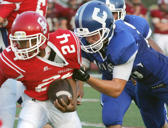 Globe/Roger Nomer<br /> Carthage's Andrew Moore gets a hold of Carl Junction's Michael Brown's jersey during Friday's jamboree at Carl Junction.