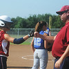 Globe/Roger Nomer<br /> Joplin's Tamarah Mascher gets a fist bump from Coach Kirk Harryman after a hit against Carthage during Saturday's Paige Neal Christina Freeman Softball Tournament at the Joplin Athletic Complex.