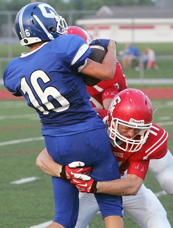 Globe/Roger Nomer<br /> Carl Junction's Pierce Griffith wraps up Carthage's Tom Simmons during Friday's jamboree in Carl Junction.
