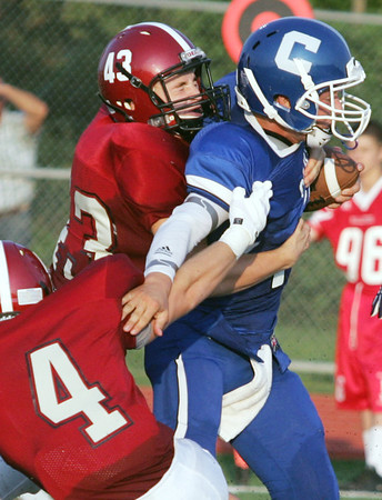 Globe/Roger Nomer<br /> Nevada's Johnathon Ireland (4) and Chance Mays (43) combine to tackle Carthage's Cameron Priester during Friday's jamboree in Carl Junction.
