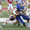Globe/Roger Nomer<br /> Monett's Levi Pfitzner twists as he brings down Carthage's Gabe Franklin for the sack during Friday's jamboree in Carl Junction.